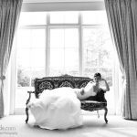 Bride laying on chaise in old hotel