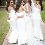 Bridesmaids' white elegant dresses